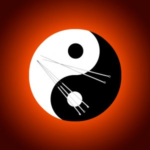 Oriental yin-yang symbol with acupuncture needles
