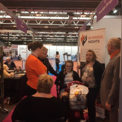 Burning Nights team talking to sufferers & their families at Naidex disability show