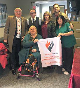 Fighting Back Against CRPS with Calmare Therapy - Burning Nights CRPS founder Victoria Abbott-Fleming, seated, toured the Calmare Therapy NJ USA's offices in March 2018. (l to r) She is shown with husband Michael Fleming, Dr. Michael Cooney, patient Star Williams with husband and Tim, and Cathy, Calmare Patient Care Coordinator. (Rutherford, New Jersey, USA.)