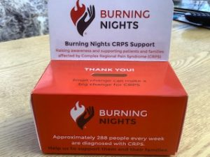 Collect loose change at home with the Burning Nights CRPS Support home collection box