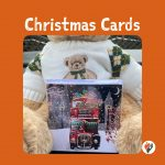 Charity Christmas Cards - Christmas Bus - Christmas card pack in front of a teddy bear w