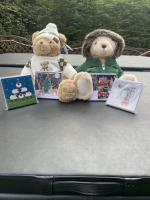 4 packs of Christmas cards in front of 2 teddy bears (bears are not for sale)